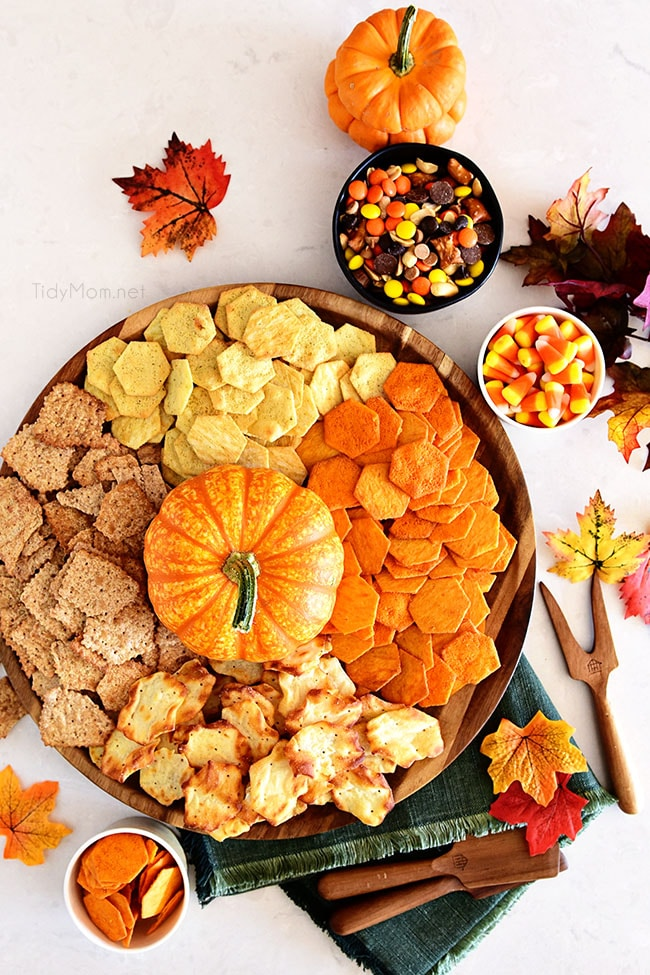round tray with crackers and a pumpkin