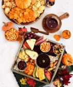 2 fall themed snack boards with sweet and salty treats