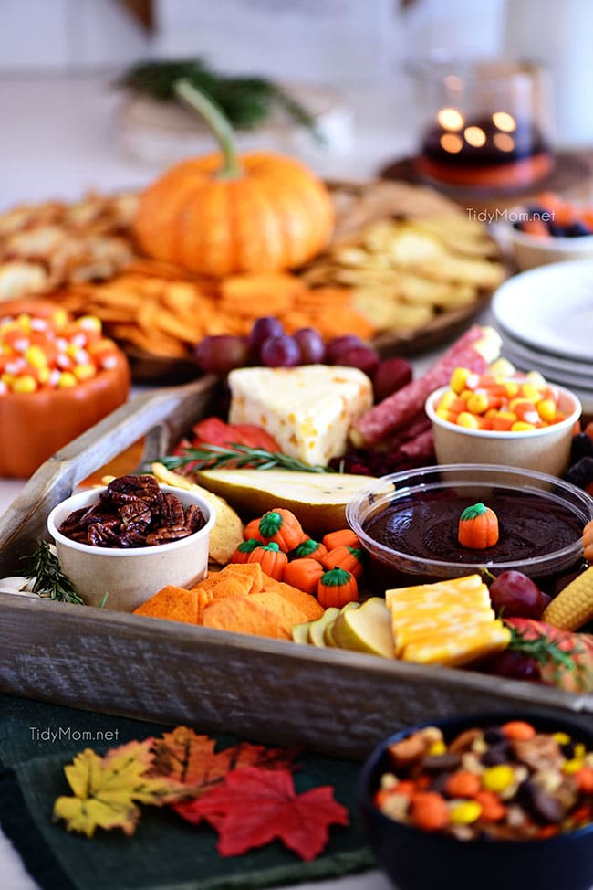 fall themed snack board with a variety of treats