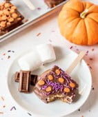 s'mores pop with halloween sprinkles on a plate