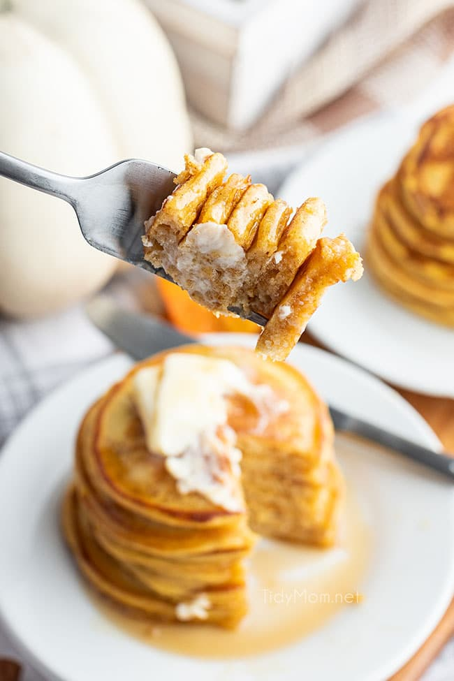 a bite of pancakes on a fork