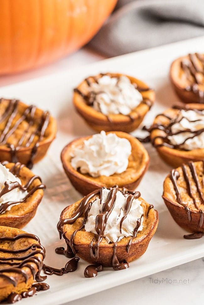 crustless mini pumpkin pies on a white platter