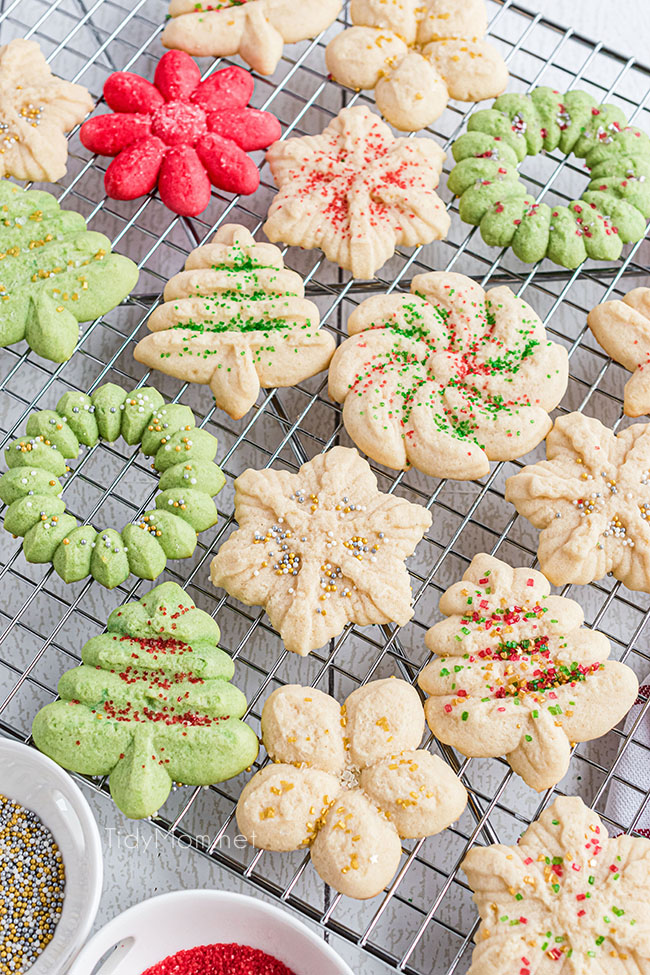 spritz cookies on a wire cooling rack