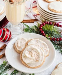 cookies on a plate with a mug of eggnog