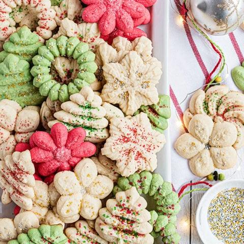 christmas spritz cookies on white platter