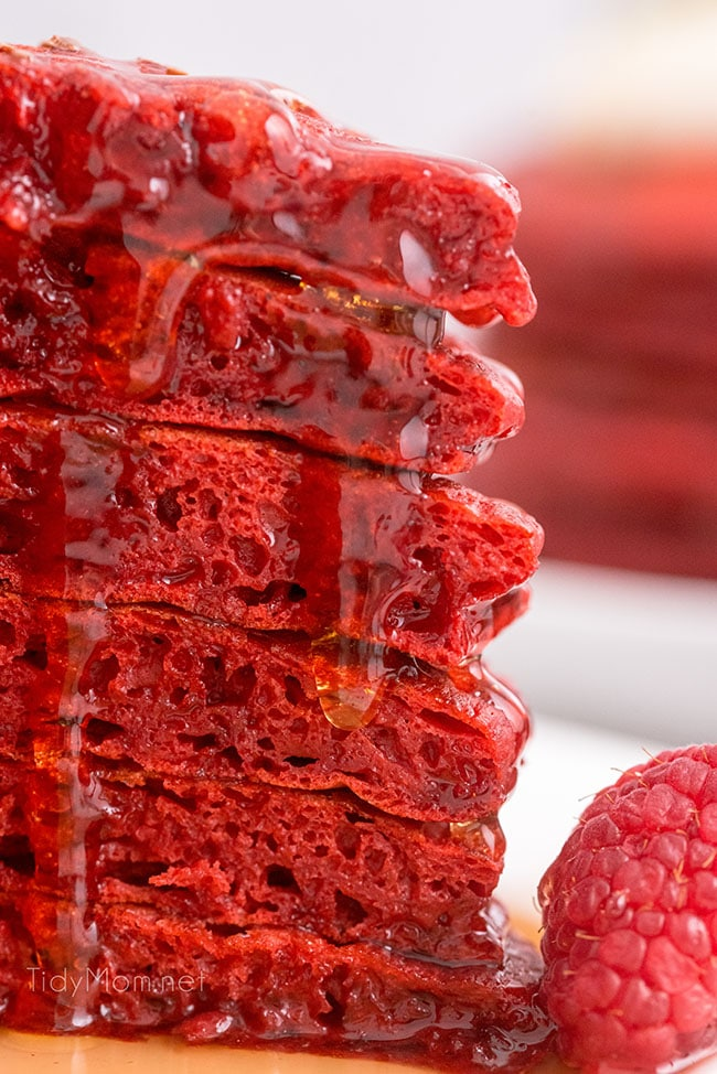 a stack of six red velvet pancakes