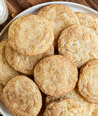 snickerdoodles piled on a white platter