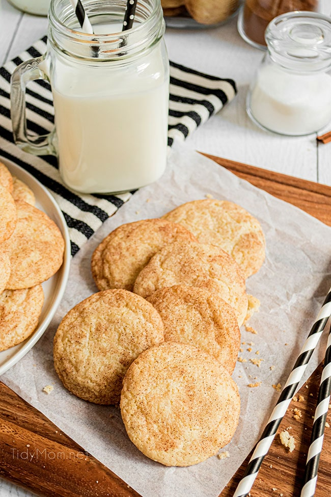 a pile of cookies with a glass of milk