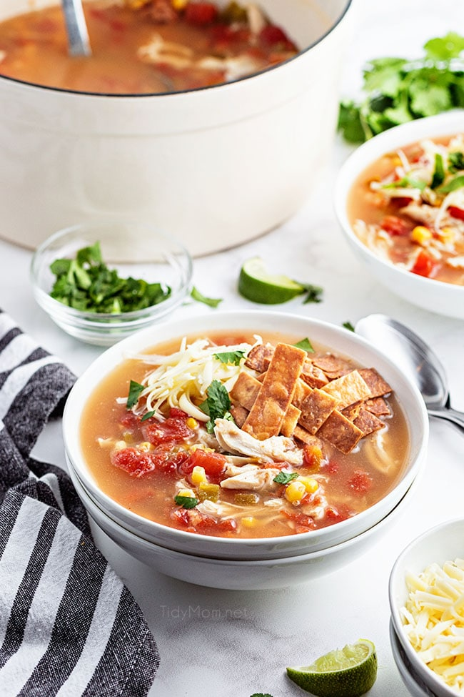 bowls of soup next to a white pot of soup