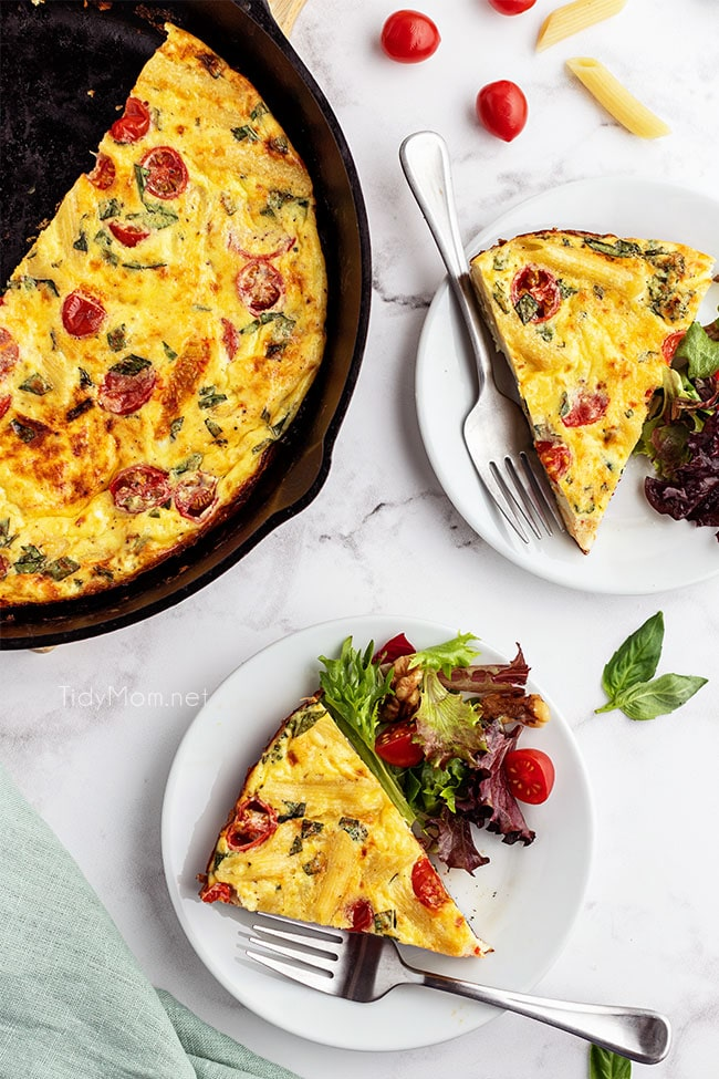 frittata in cast iron skillet and slices on plates