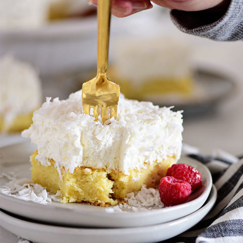 coconut cake with a gold fork poking into it