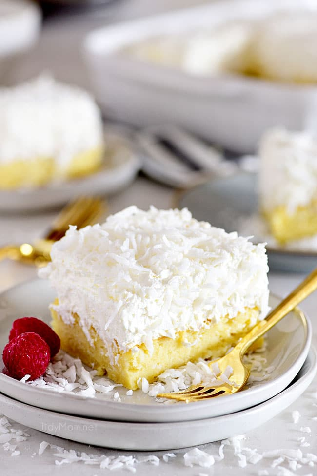 coconut cake on a plate with a gold fork