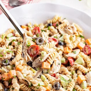 big bowl of pasta salad with a serving spoon