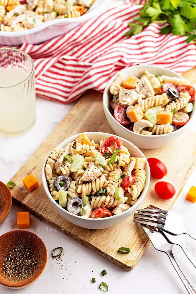 two bowls of pasta salad with tomatoes