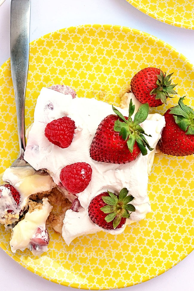 overhead shot of no-bake strawberry cheesecake lush on a yellow plate