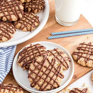 overhead shot of cookies with chocolate drizzle on a plate