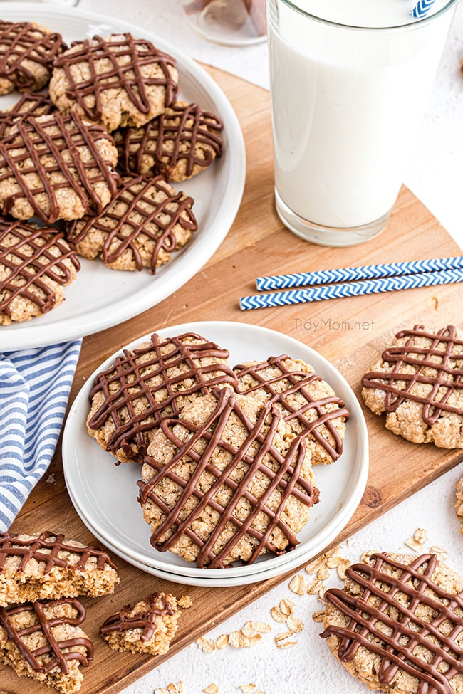 overhead shot of oatmeal cookies with chocolate drizzle on a plate