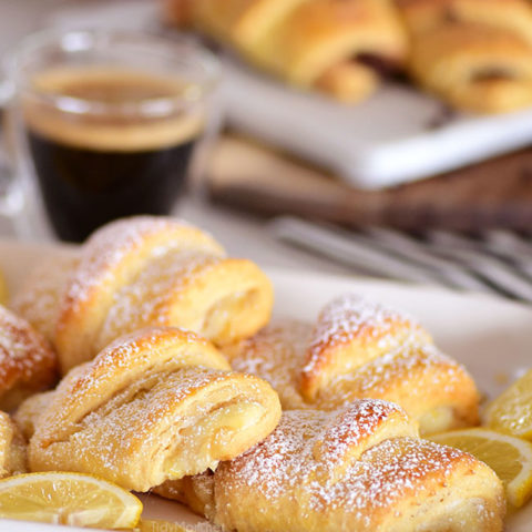 lemon cheesecake crescent rolls with a cup of coffee