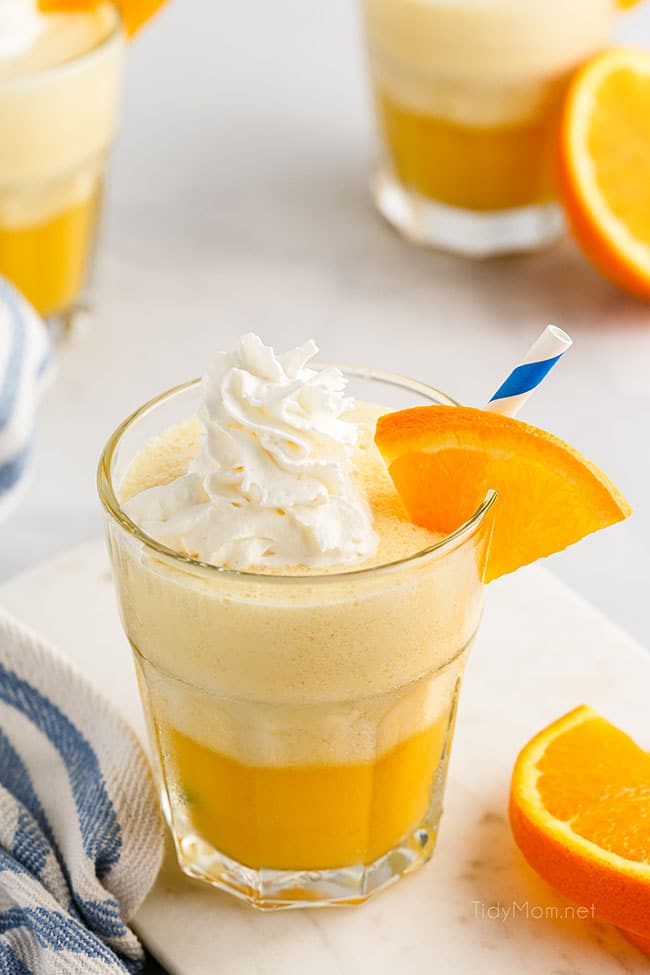 a glass fill with an Orange Julius and topped with whipped cream
