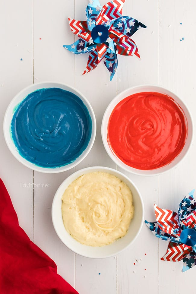 3 bowls with red, white and blue cake batter