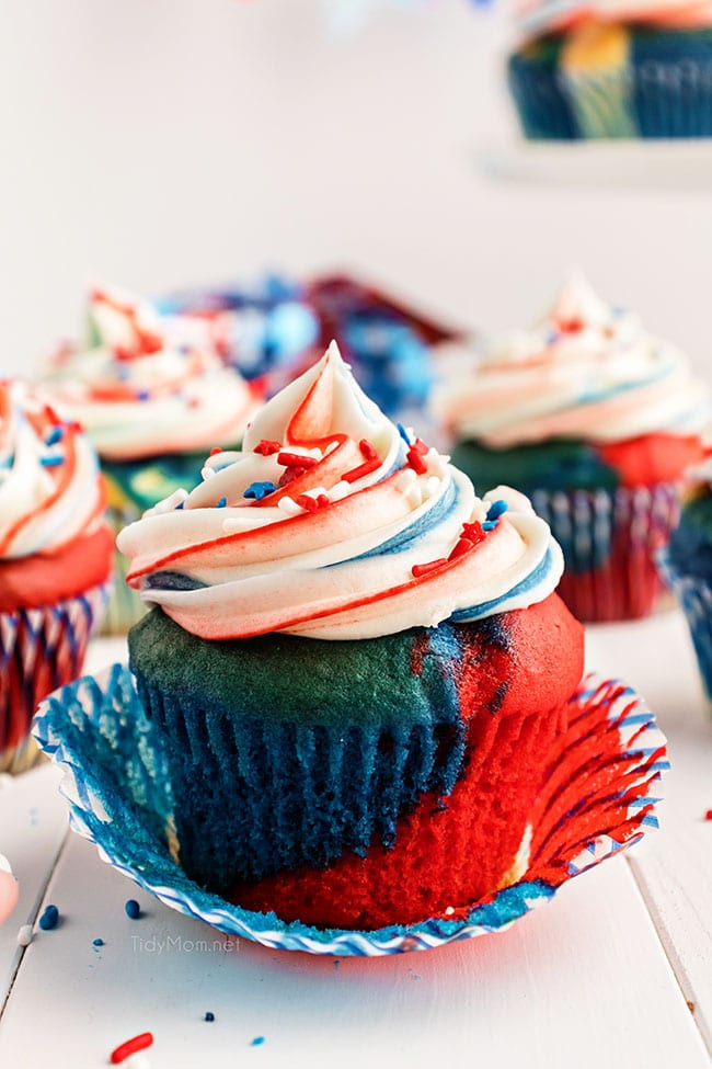 red white and blue cupcake with the wrapper pulled down.