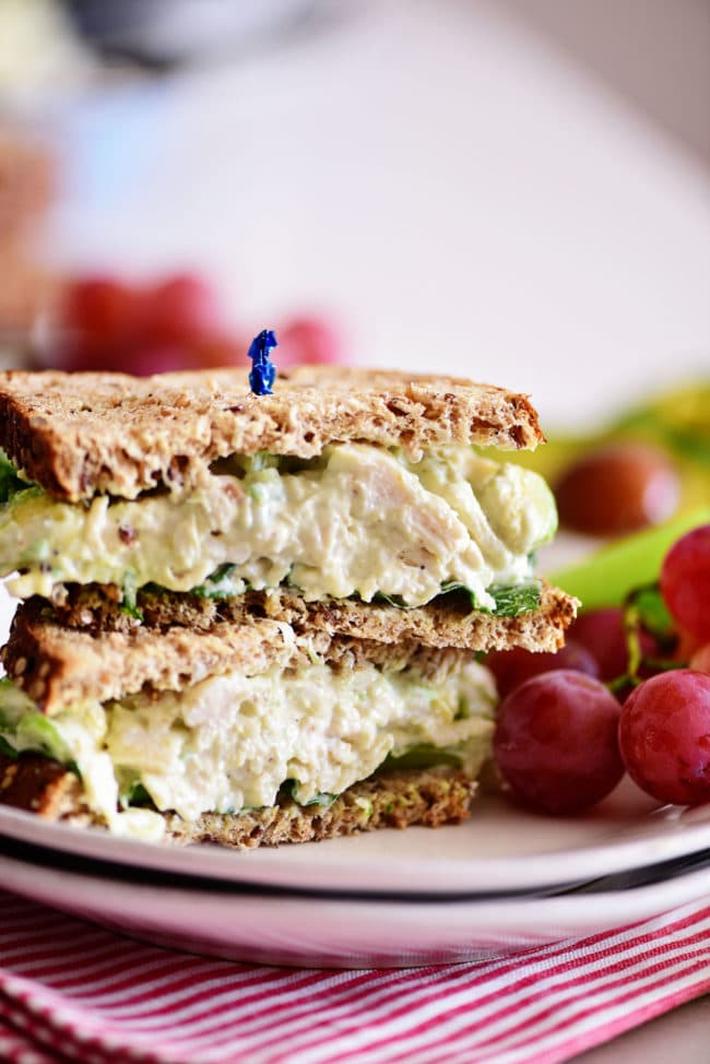 avocado chicken salad sandwich cut in half and stacked