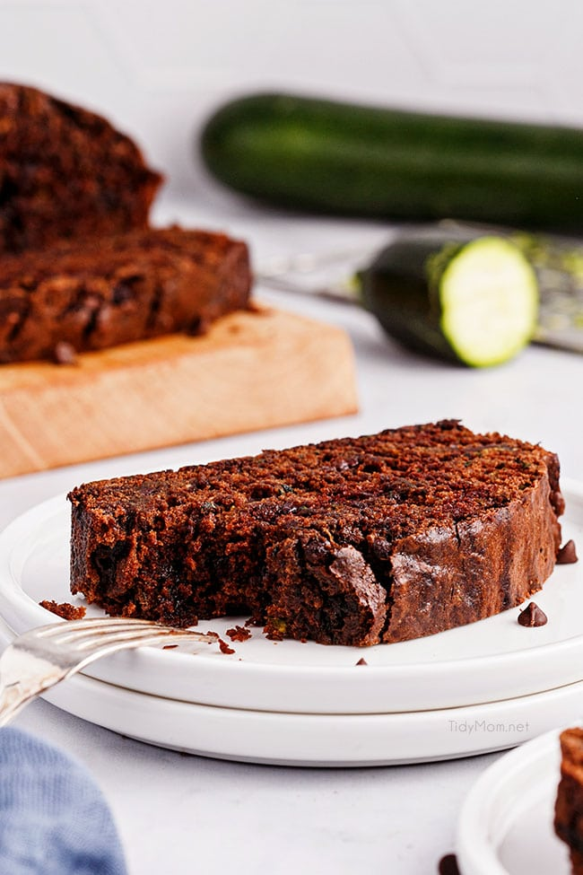 a slice of chocolate zucchini bread on a white plate
