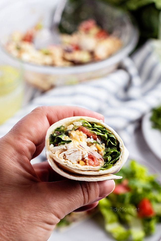 woman's hand holding chicken wrap