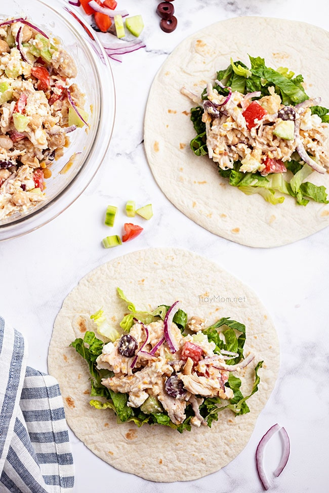 flour tortillas on a counter with greek chicken filling