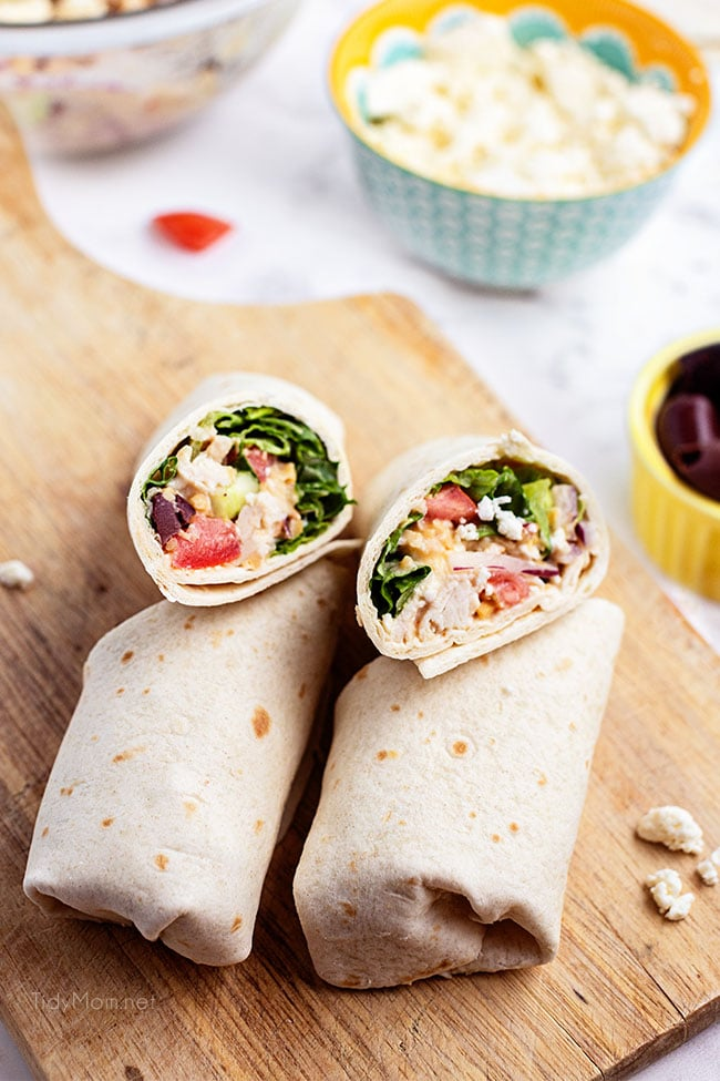 2 chicken wraps on a cutting board