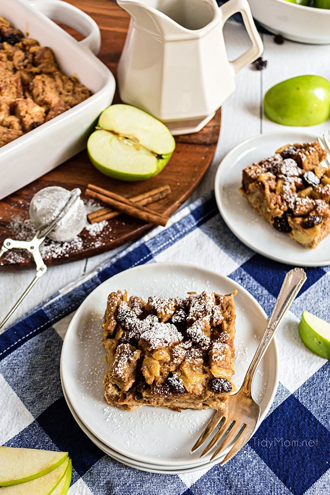 apple bread pudding with a sprinkle of powdered sugar on plates