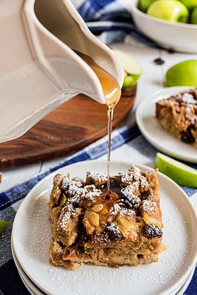 pouring syrup on a serving of bread pudding