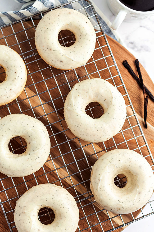 glazed cinnamon donuts on a cooling rack