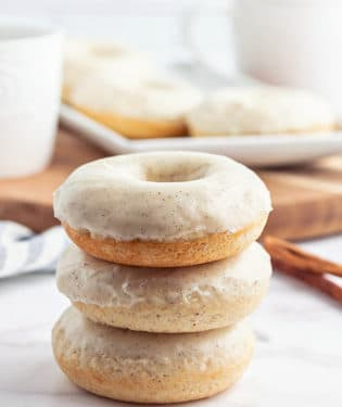 a stack of glazed cinnamon donuts