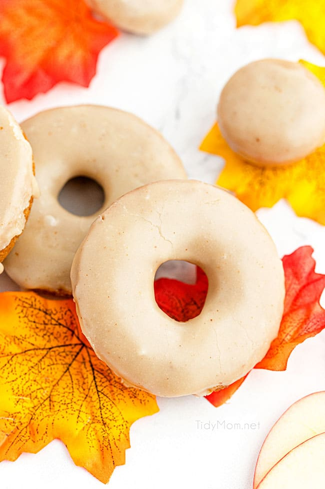 glazed apple cider donuts with colorful fall leaves
