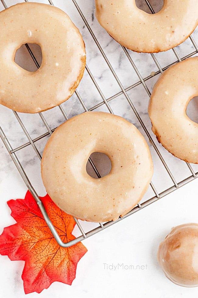 glazed apple cider donuts on a cooling rack