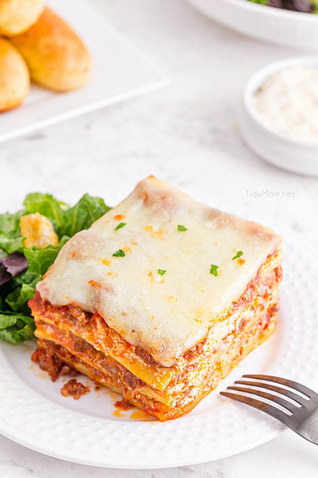 The Best Homemade Lasagna on a white plate