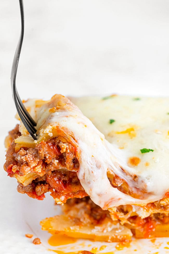 A bite of homemade lasagna on a fork