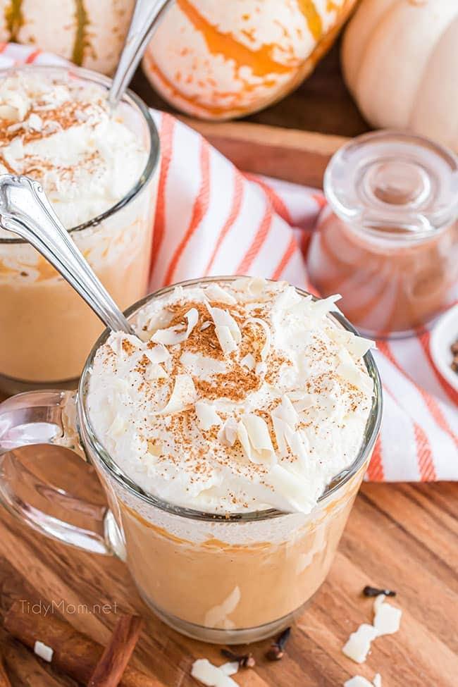 pumpkin hot chocolate in a glass mug with a spoon